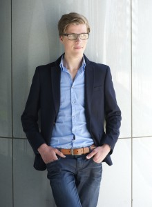 Portrait of a young businessman with glasses standing outdoors