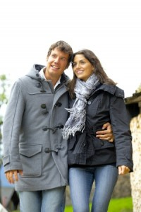 iStock_couple wearing coats_Medium